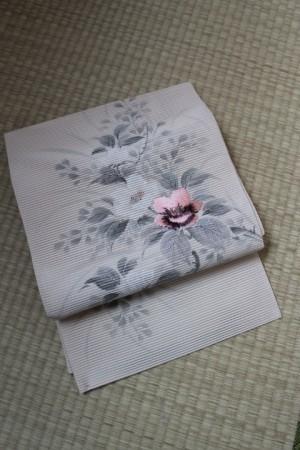 白地絽花文染帯